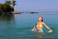 Free Happy Young Woman Playing In The Sea Stock Photo - 25970530