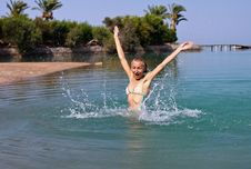 Free Happy Young Woman Playing In The Sea Royalty Free Stock Images - 25970619