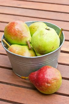 Fresh Colourful Pears In Bowl On Wooden Backgro Stock Image