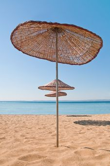 Free Umbrellas On Tropical Beach Royalty Free Stock Image - 25974036