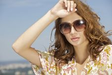 Free Beautiful Girl In Sunglasses On Blue Sky Royalty Free Stock Photo - 25974085