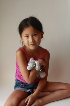 Little Asian Girl With Stuffed Animal Royalty Free Stock Photo