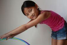 Little Asian Girl With Hula Hoop Stock Photos