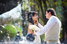 Happy Bride And Groom With Bouquet Stock Photography