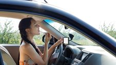 Female Driver Applying Make-up Stock Photos