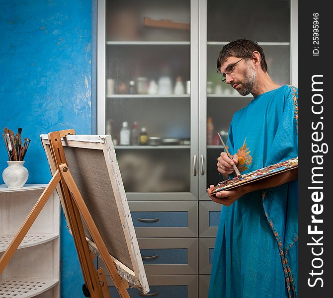 Artist paints picture in the studio
