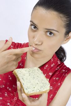 Free Girl Eating Slice Of Bread Royalty Free Stock Image - 2603166