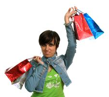 Free The Happy Girl With Purchases Royalty Free Stock Photo - 2605815