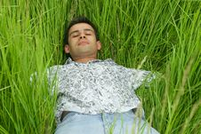 Free Boy Relaxing In High Grass Royalty Free Stock Images - 2606139