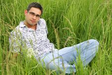 Young Man In The Grass Stock Photo
