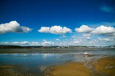 Free Welsh Coast Lone Boat Cloudscape Royalty Free Stock Photography - 26001197