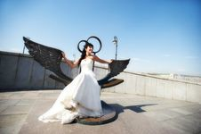 Free Bride On Bronze Bench With Wings Royalty Free Stock Photography - 26001237