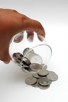 Free Coins Spilling From The Glass Royalty Free Stock Photography - 26003397