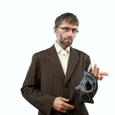 Free Man In A Suit Proposes BDSM Mask Stock Photos - 26005343