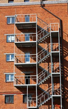 Free Metal Ladder At The Wall Of The House Stock Photo - 26008360