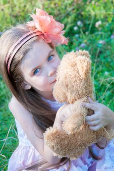 Free Little Girl With A Toy Royalty Free Stock Photo - 26015905