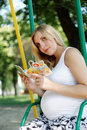 Free Pregnant Girl In A Park With A Book Stock Images - 26044404
