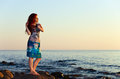 Free Girl On Seacoast Before A Sunset Stock Photo - 26048580