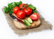 Tomatoes And Cucumbers On The Board Royalty Free Stock Image