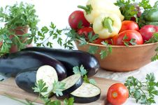 Fresh Aubergines, Whole And Sliced Stock Photos