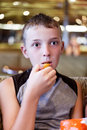 Free Boy Eats Thoughtfully Royalty Free Stock Images - 26051949