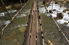 Free Hanging Bridge Over Waterfall Stock Images - 26057044