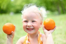 Free Portrait Of Laughing Girl With Oranges Royalty Free Stock Photo - 26060125