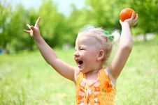 Free Portrait Of Happy Girl Plays With Oranges Stock Image - 26060181