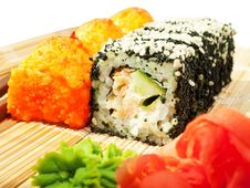 Free Rolls With Black Roe And Sesame And Baking Sushi Royalty Free Stock Photography - 26074377
