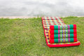 Free Triangular Pillows And Mattresses On The Grass. Royalty Free Stock Image - 26089696