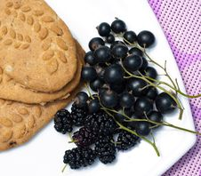 Black Fruits And Biscuits Royalty Free Stock Photo