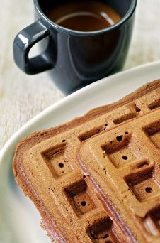 Free Homemade Brown Waffles On The Plate With A Cup Of Coffee Royalty Free Stock Photography - 26089647