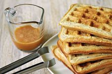 Free Stack Of Homemade Waffles On The Plate With A Cup Of Brown Syrup Stock Images - 26089794