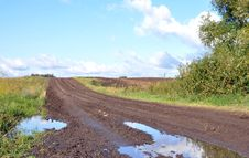 Free Road To A Field After Rain Royalty Free Stock Photos - 26093488