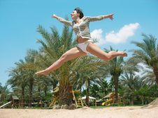 Free Jumping On A Beach Stock Photo - 2612630