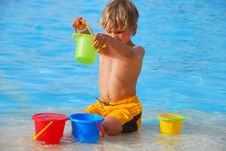 Free Boy Playing In Pool Stock Photos - 2617023