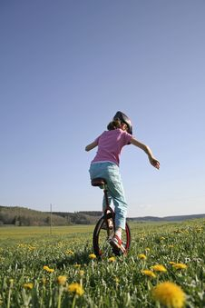 Young Girl On Monocycle Royalty Free Stock Images