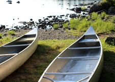 Free Early Morning Sunshine On Two Canoes Stock Photos - 26109053