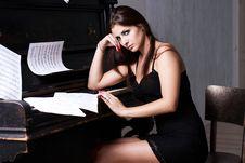 Free Sad Girl Near Piano Royalty Free Stock Images - 26116829