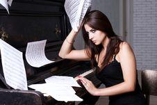 Free Sad Girl Near Piano Stock Photography - 26116892