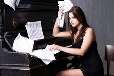 Free Sad Girl Near Piano Royalty Free Stock Image - 26116906