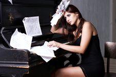 Free Sad Girl Near Piano Royalty Free Stock Image - 26116926