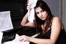 Free Sad Girl Near Piano Royalty Free Stock Images - 26116949