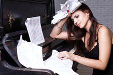 Free Sad Girl Near Piano Royalty Free Stock Photography - 26116967