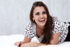 Free Brunette In Her Bed Royalty Free Stock Photography - 26117357