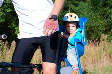 Little Boy In Bike Child Seat Stock Photo