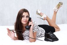 Free Brunette Talking On The Retro Phone Royalty Free Stock Photography - 26117417
