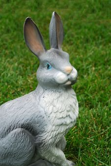 Plastic Bunny On A Grass Stock Photo