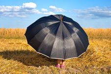 Free Little Girl Hiding Under Umbrella Stock Photography - 26134152