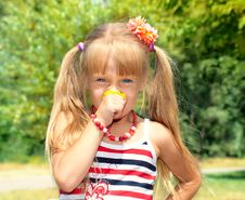 Little Girl Smelling Flower Royalty Free Stock Photos
